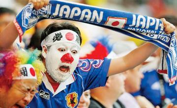 Japan fans clean up stadium after World Cup match