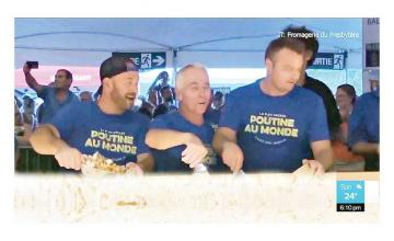 Cheesemakers create 6,700 pounds of poutine for world record