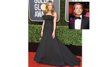 Jennifer Aniston seemed quite happy to see Brad Pitt bag a Golden Globe