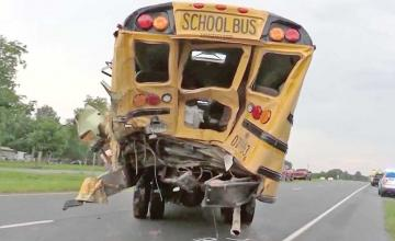 Truck driver dies after helping children get out of school bus crash